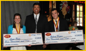 2012 Straight 'A' winners Anne Pace of Seton High School and Robert Pieper of Eaton High School stand with Anthony Munoz