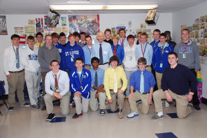 Roger Grein with students at St. Xavier High School