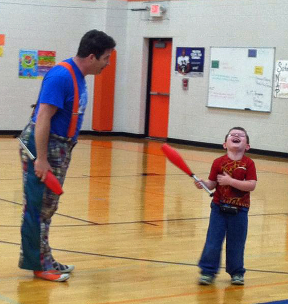 Paul Miller of Circus Mojo with a student at Williamstown Elementary School