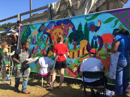 To celebrate its 75th anniversary, Amberley Village in Cincinnati worked with artist Cedric Michael Cox and residents to create this permanent mural.