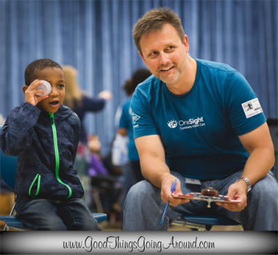 OneSight volunteer David Brown helped provide free vision screenings to Cincinnati area students