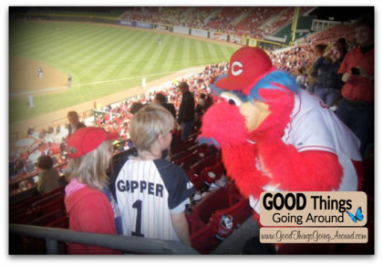 Cincinnati Reds mascot Gapper with a fan