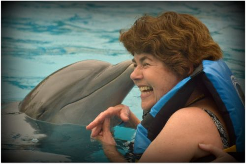 Sandy Desatnik swimming with a dolphin